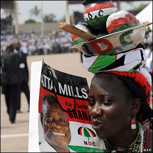 A supporter of the National Democratic Congress kisses the portrait of President John Atta Mills