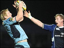 Bradley Davies of Cardiff Blues claims the ball ahead of Leinster's Leo Cullen