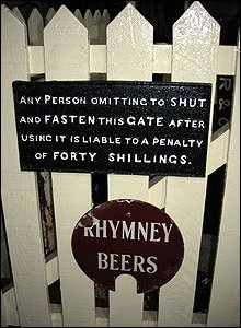 Cast iron gate signs