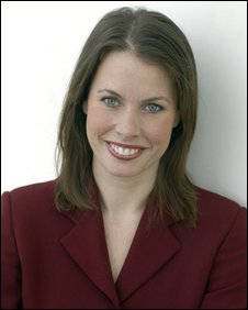 Head and shoulder shot of Nina Ridge wearing a maroon jacket.