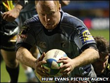 Skipper Martyn Williams crosses for one of nine Blues tries