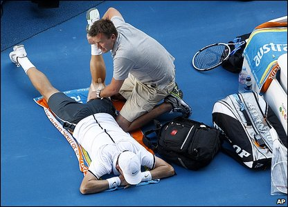 Tomas Berdych receives treatment