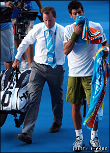 Novak Djokovic (right) and the tournament doctor