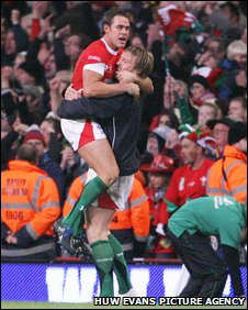 Andy Powell and Lee Byrne celebrate as Wales secured a rare Tri Nations scalp last November