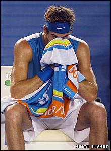 Del Potro wipes his face following defeat