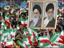 Iranians hold up photos of Iran's late leader Ayatollah Khomeini on 10 February 2009