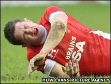 Shane Williams winces in pain at Murrayfield on Sunday