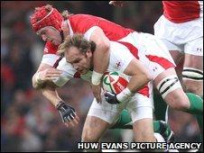 Wales lock Alun Wyn Jones stops England fly-half Andy Goode in his tracks