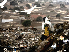 Man at a waste dump in Lagos, Nigeria