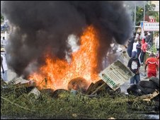 People burn tires on 18 February in Pointe-a-Pitre