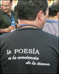 Man with a T-shirt reading Poetry: Conscience of the Earth