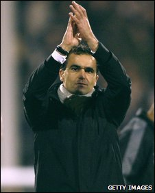 Roberto Martinez applauds the Swansea fans after their 2-1 cup defeat at Fulham
