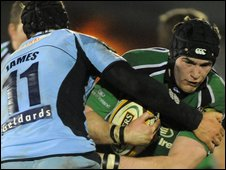 Tom James of the Blues tackles Connacht opponent Andrew Browne