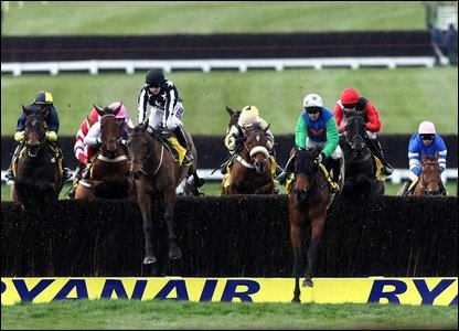 Horses jump one of the fences in the Ryanair Chase