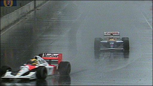 Ayrton Senna leads Nigel Mansell