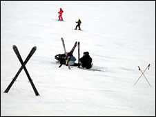 Crossed skis in the snow warn of an accident