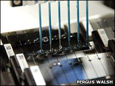 DNA samples being washed over silicon slides
