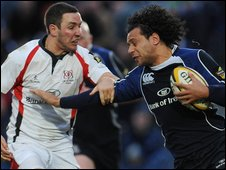 Paddy Wallace challenges Leinster's Isa Necewa at the RDS