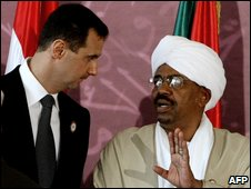 Syrian President Bashar al-Assad (left) and Sudan's President Omar al-Beshir during the opening session of the Arab League summit in Qatar