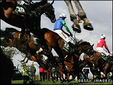 Horses jump one of the Aintree fences