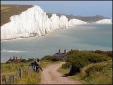 Two fishermen on the path to Cuckmere Haven from Seaford head in Seven Sisters