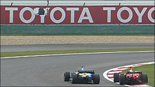 Michael Schumacher overtakes Giancarlo Fisichella