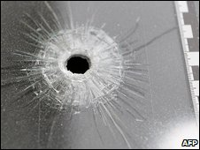Bullet hole in glass (file pic)
