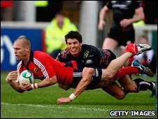 Man-of-the-match Paul Warwick crosses for Munster's first try in the Heineken Cup quarter-final against the Ospreys at Thomond Park