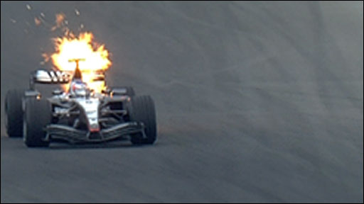 Kimi Raikkonen's McLaren catches fire