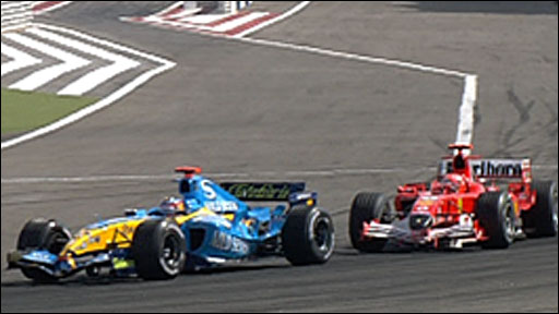 Fernando Alonso fends off the challenge of Michael Schumacher