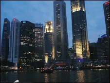 The old Clark Quay and city skyline of Singapore