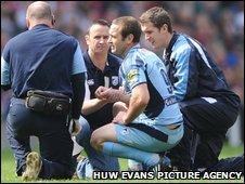 Jason Spice recieves treatment at Twickenham