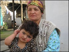 Tajik woman with grandchild
