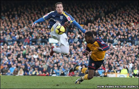 2009: Cardiff City striker Ross McCormack gets the ball ahead of Arsenal's Johan Djourou in the last FA Cup game at Ninian Park