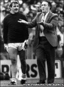 1985: Wales goalkeeper Neville Southall chats to Scotland manager Jock Stein before their World Cup qualifier, just hours before Stein collapsed and died