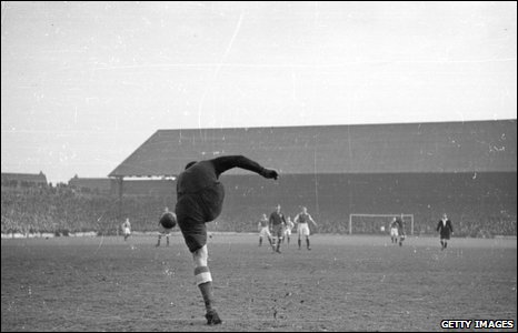 1945: Dynamo Moscow keeper Khomich kicks the ball in their war-time friendly with Cardiff City at Ninian Park as the Russians won 10-1