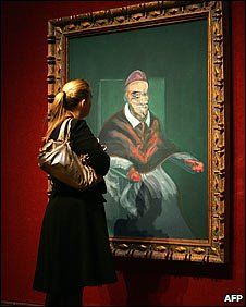 A woman at a Christie's auction house in London looks at 'study from Portrait of Pope Innocent X by Velazquez' painted by Francis Bacon (Photo: JOHN D MCHUGH/AFP/Getty Images)