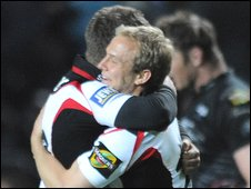 Edinburgh players celebrate after their win at the Ospreys