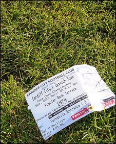 A ticket lies discarded on the Ninian Park turf after a frustrating last league game