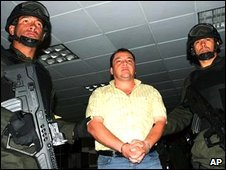 Police officers guard Eugenio Montoya in Bogota, Colombia, file photo from January 2007