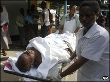 A man injured in the blast is taken to a hospital emergency room in Dar es Salaam, Tanzania, on 29 April 2009