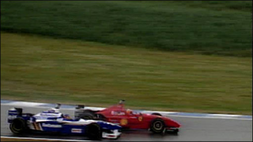 Jacques Villeneuve and Michael Schumacher in action