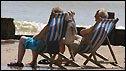 Sunbathers sitting on a beach