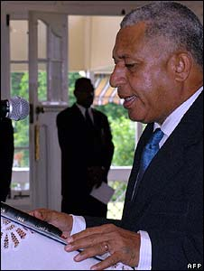 Frank Bainimarama is sworn in as interim prime minister at Government House in Suva on 11 April (Fiji Times handout/AFP)