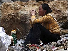 A Chinese woman grieves for her lost ones in Beichuan