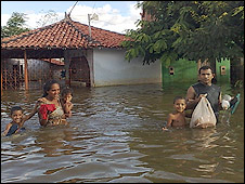 Walking through flood waters in Trizidela do Vale