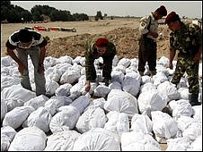 The remains of Iraqi soldiers killed during different wars are made ready for burial close to Basra  (file photo)