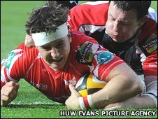Scarlets scrum-half Martin Roberts beats the Ulster defence to score