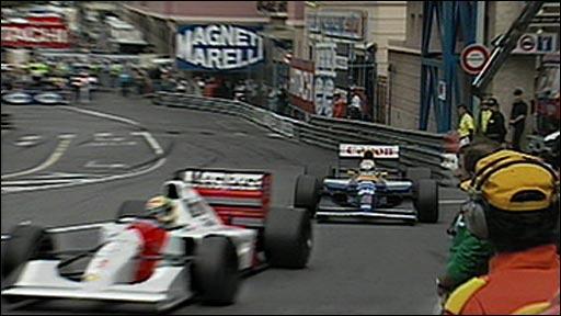 Ayrton Senna holds off Nigel Mansell
