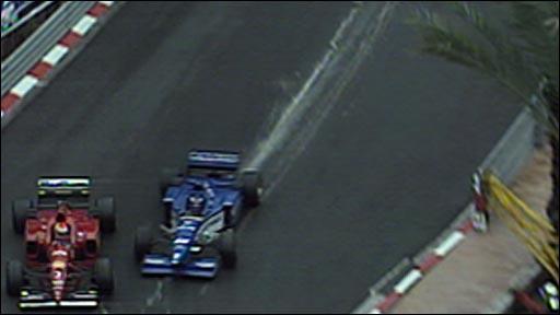 Olivier Panis gets past Eddie Irvine